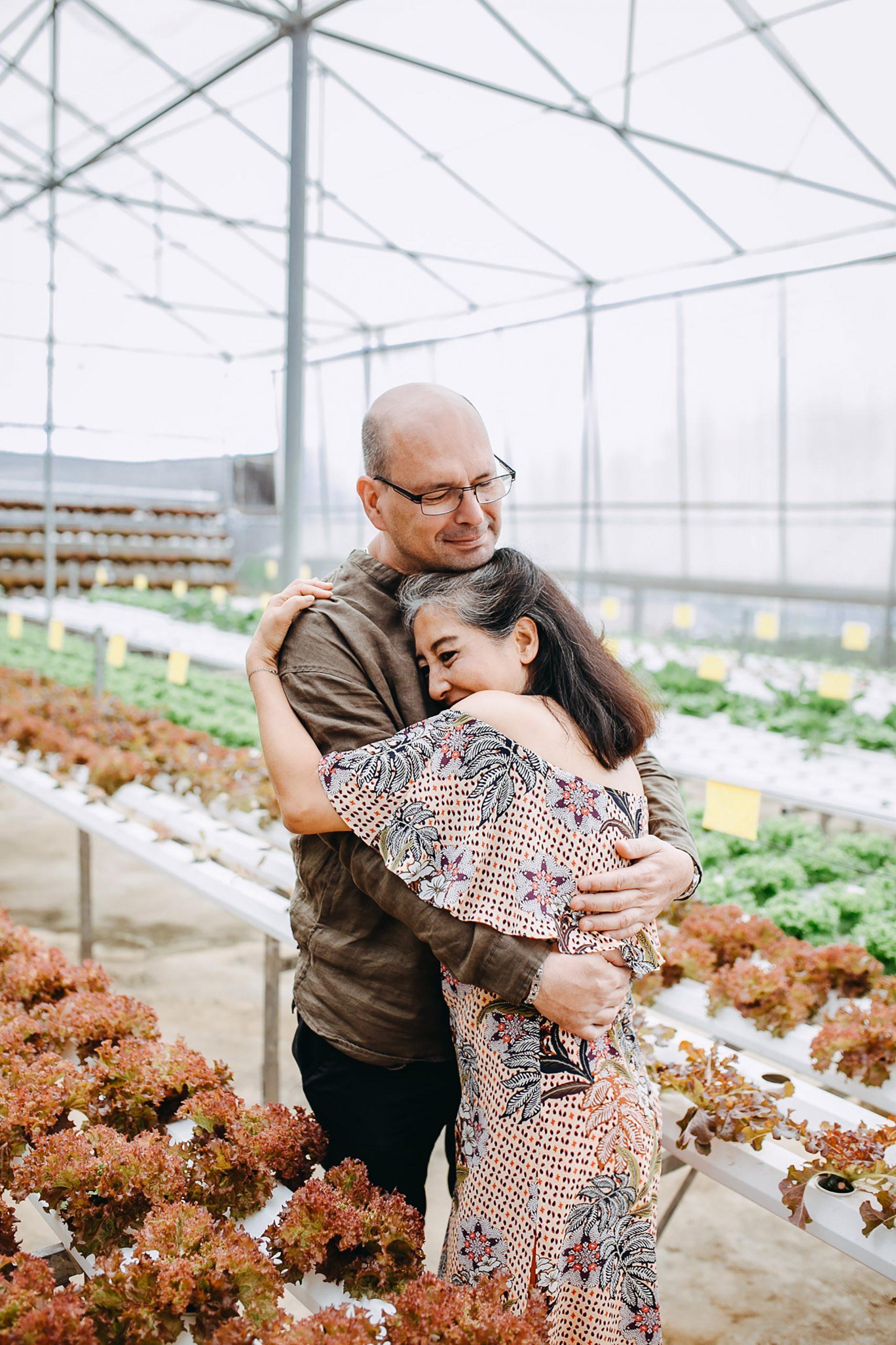 OlderCouple.Hug.Greenhouse